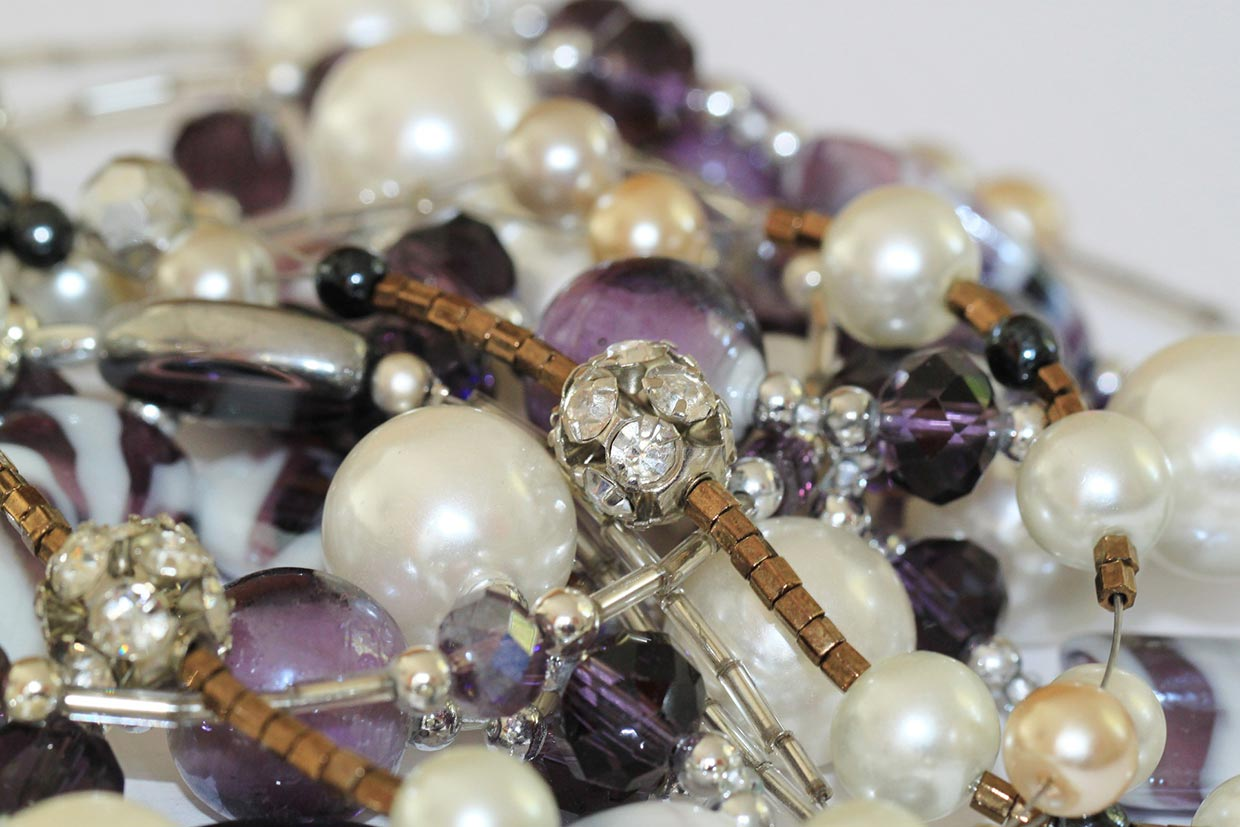 pile of pearls and purple gemstones