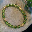 Green Peridot round gemstone with gold metal spacer beads stretch bracelet