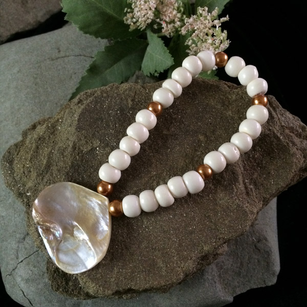 Glass white beads bracelet with gold accents and genuine shell