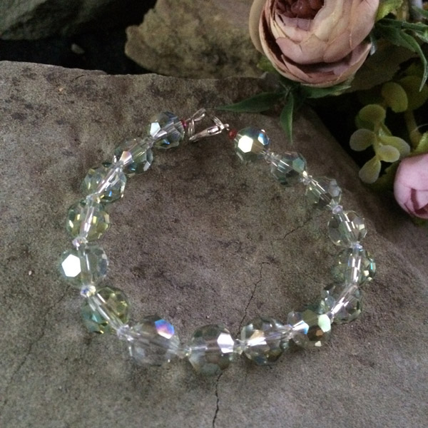 Chinese crystal transparent green (10mm faceted) bracelet