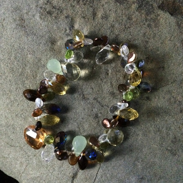 Multi-coloured Czech glass, Swarovski crystal and glass teardrop style stretch bracelet