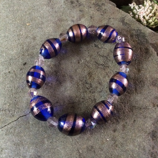 Italian Murano glass bead oval copper and blue with clear crystal stretch bracelet
