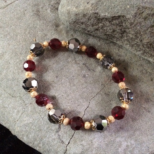 Dark red and smokey grey faceted Czech glass and Chinese crystal stretch bracelet