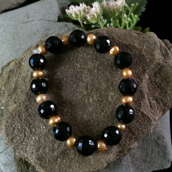 Black faceted glass beads with gold dyed fresh water pearls bracelet