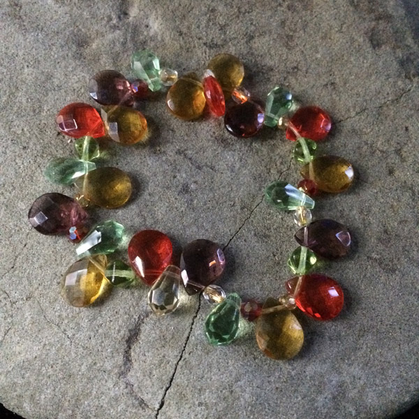 Swarovski crystal flat teardrop beads and round multi-coloured ,faceted stretch bracelet