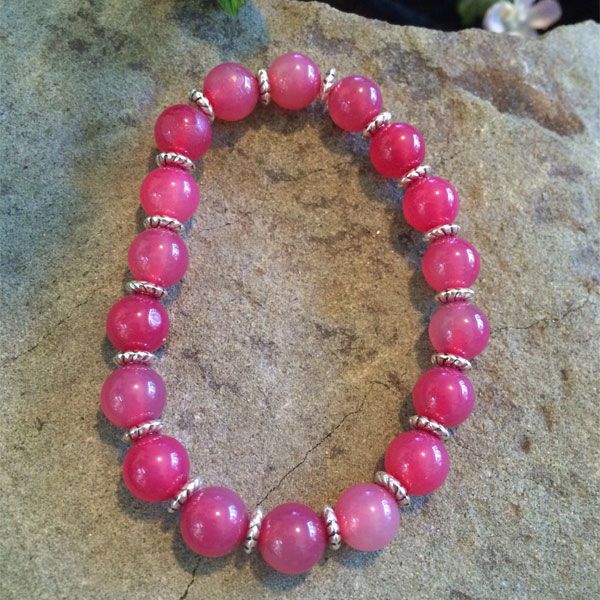 Pink Rhodonite 6mm beads with silver plated rondelle beads in stretch bracelet