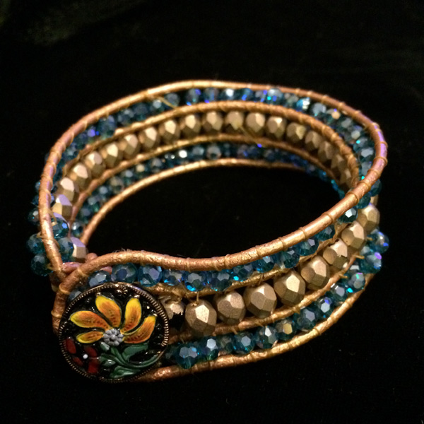 Czech glass and Chinese crystal bracelet with enamal button and gold leather