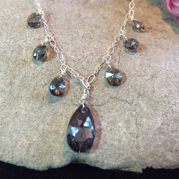 Dark smokey grey Swarovski crystal teardrop pendant necklace. Sterling silver chain.