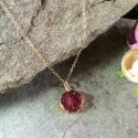 Dark red Crystal druzy round agate gemstone (0.5 in diam.) with plated gold