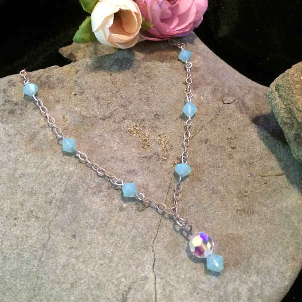 Pale turquoise colour bicone Swarovski crystal beads