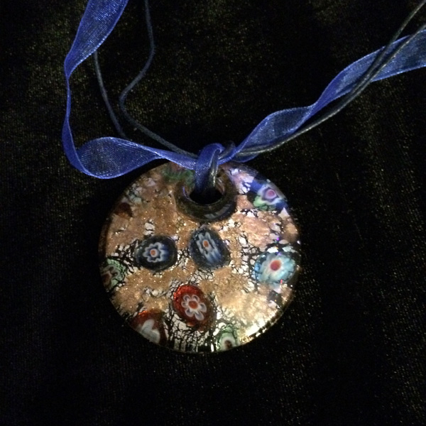 Murano round glass pendant with blue cloth band and clasp ($39)