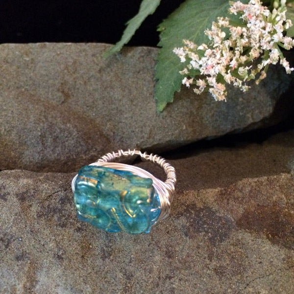 Aqua colored rectangular ring with hints of gold color ($35) Sterling silver wire option