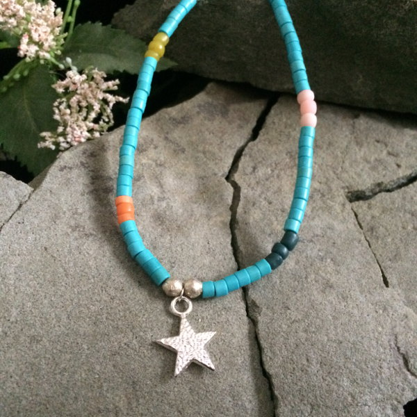 Turquoise dyed magnesite gemstone with coloured glass stones and metallic star pendant